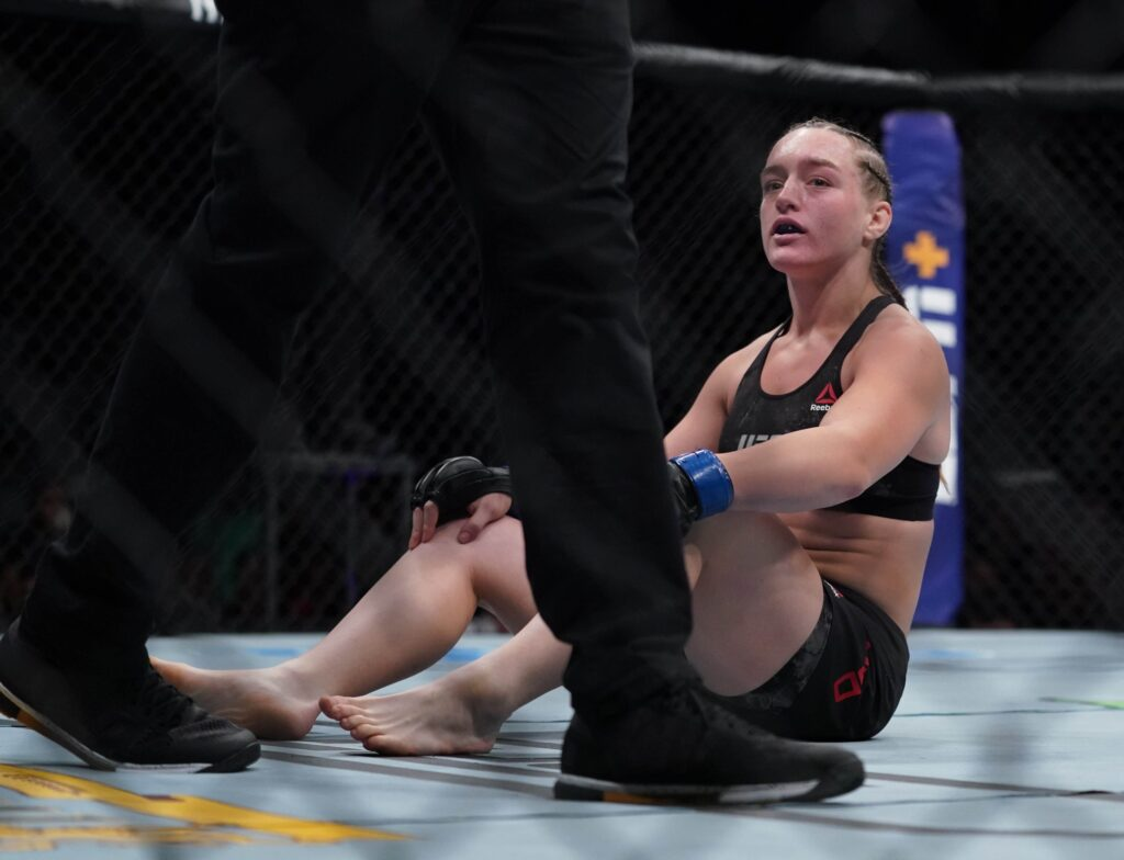 July 13, 2019; Sacramento, CA, USA; Aspen Ladd (blue gloves) after losing to Germaine de Randamie (red gloves) during UFC Fight Night-Sacramento at Golden 1 Center. Mandatory Credit: Kyle Terada-USA TODAY Sports