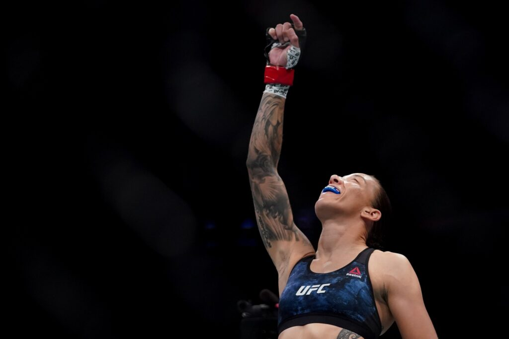 July 13, 2019; Sacramento, CA, USA; Germaine de Randamie (red gloves) fights Aspen Ladd (blue gloves) during UFC Fight Night-Sacramento at Golden 1 Center. De Randamie defeated Ladd via TKO (punch) – Round 1, 0:16. Mandatory Credit: Kyle Terada-USA TODAY Sports