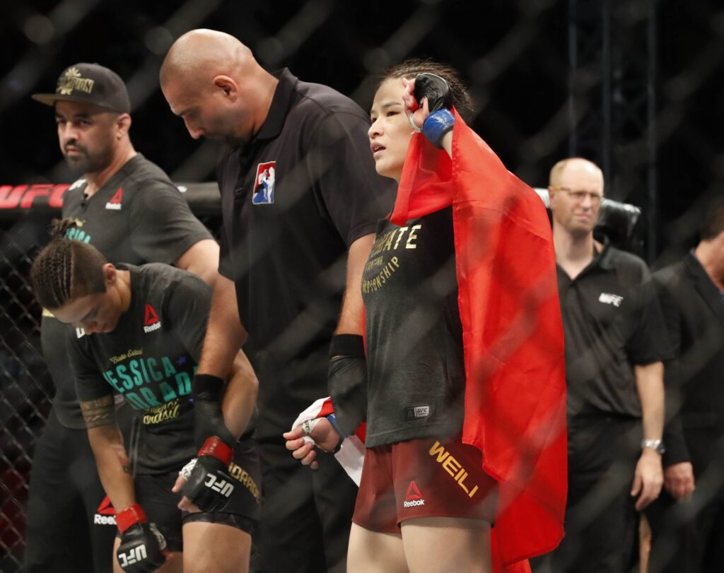 Aug 31, 2019; Shenzhen, China;  Zhang Weili (blue gloves) defeats Jessica Andrade (red gloves) during UFC Fight Night at Shenzhen Universiade Sports Centre. Mandatory Credit: David G. McIntyre-USA TODAY Sports