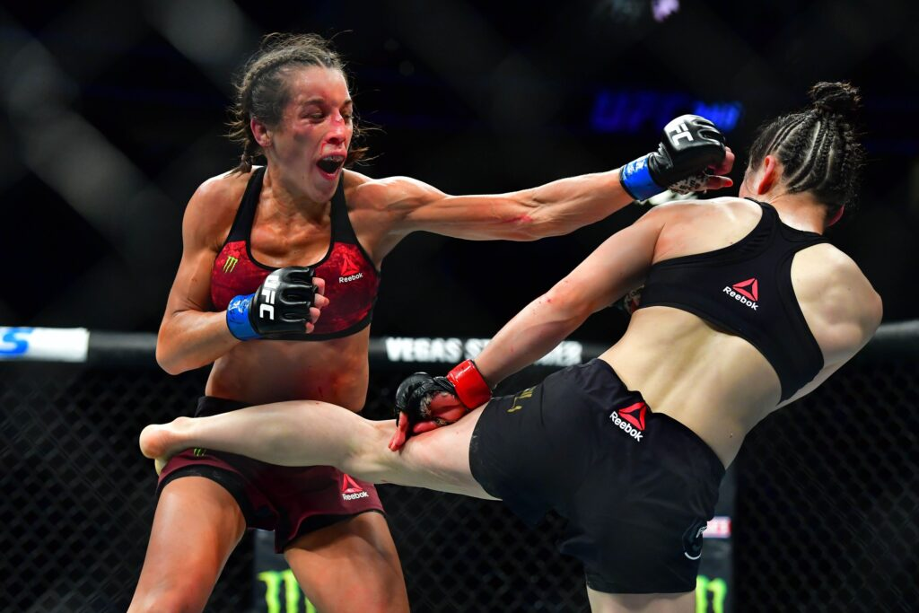 Mar 7, 2020; Las Vegas, Nevada, USA; Weili Zhang (red gloves) fights Joanna Jedrzejczyk (blue gloves) during UFC 248 at T-Mobile Arena. Mandatory Credit: Stephen R. Sylvanie-USA TODAY Sports