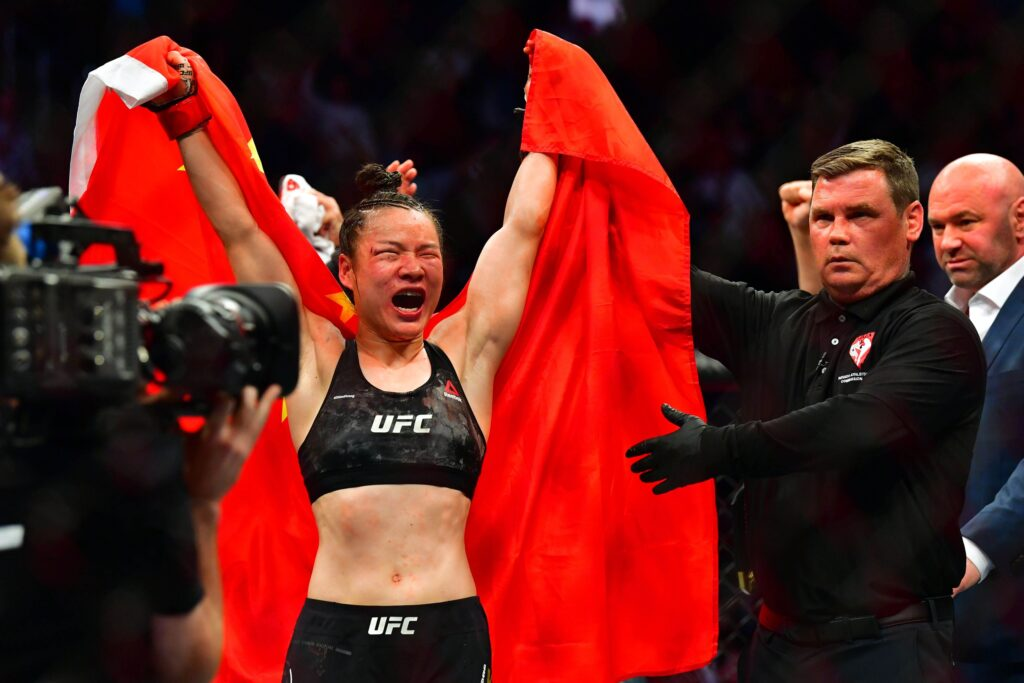 Mar 7, 2020; Las Vegas, Nevada, USA; Weili Zhang (red gloves) celebrates beating Joanna Jedrzejczyk (blue gloves) during UFC 248 at T-Mobile Arena. Mandatory Credit: Stephen R. Sylvanie-USA TODAY Sports