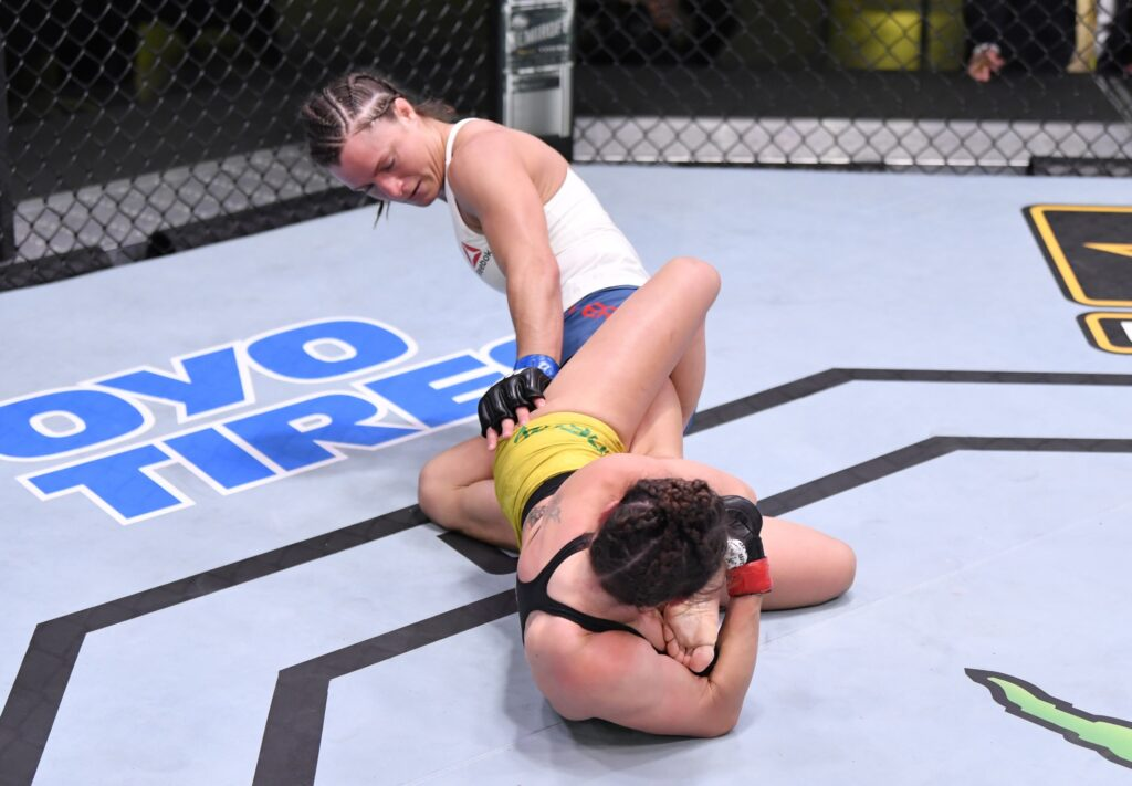 May 30, 2020; Las Vegas, NV, USA; Mackenzie Dern (red gloves) secures a knee bar submission against Hannah Cifers (blue gloves) in their strawweight fight during UFC Fight Night.  Mandatory Credit: Jeff Bottari/Zuffa via USA TODAY Sports