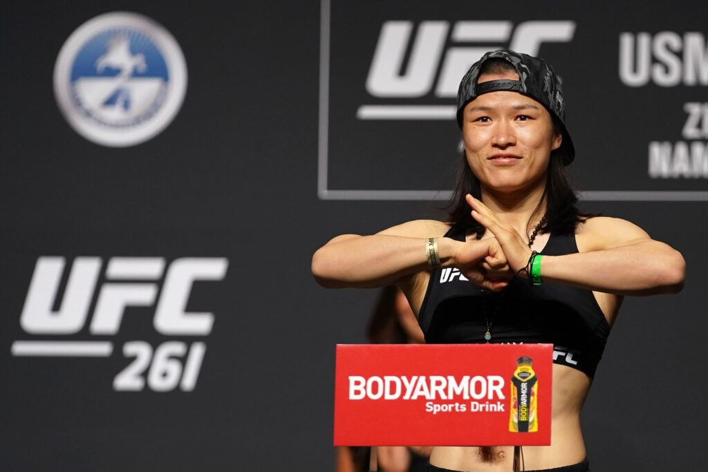 Apr 23, 2021; Jacksonville, Florida, USA; Zhang Weili gestures while on the scale during weigh-ins for UFC 261 at VyStar Veterans Memorial Arena. Mandatory Credit: Jasen Vinlove-USA TODAY Sports