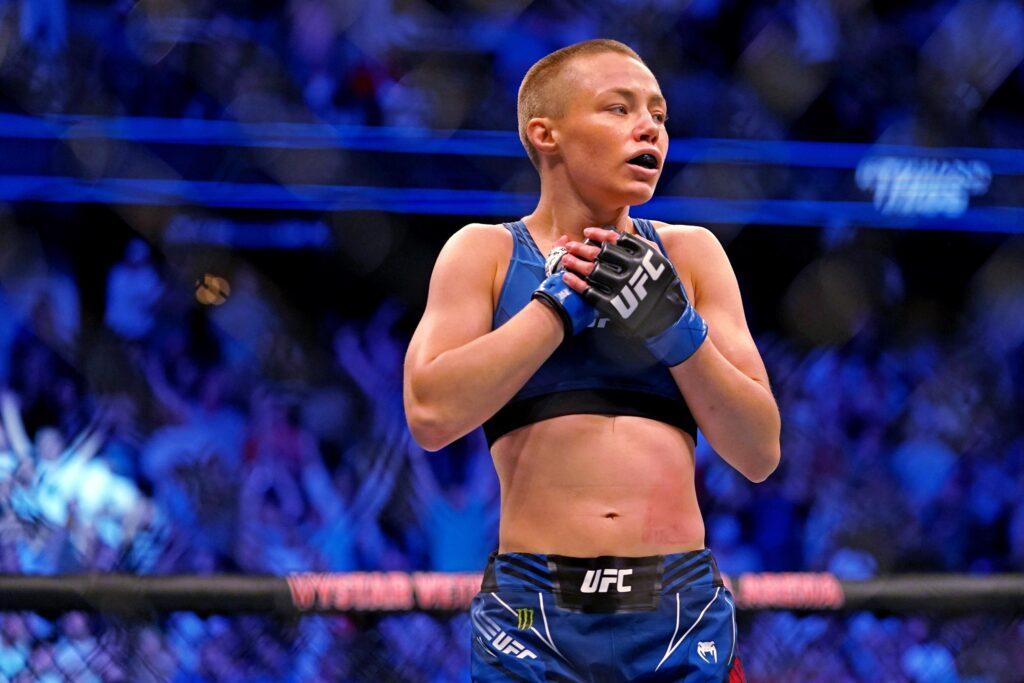 Apr 24, 2021; Jacksonville, Florida, USA; Rose Namajunas (Blue Gloves) reacts after defeating Zhang Weili (Red Gloves) during UFC 261 at VyStar Veterans Memorial Arena. Mandatory Credit: Jasen Vinlove-USA TODAY Sports
