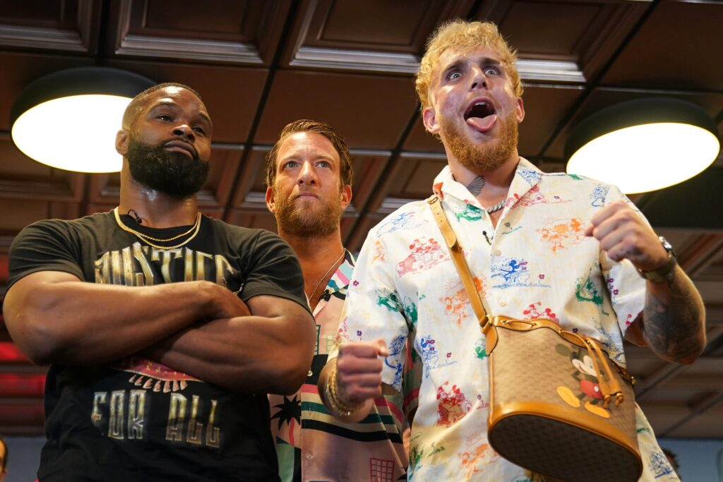 Jun 3, 2021; Miami Beach, Florida, USA; Professional MMA fighter Tyron Woodley and YouTube star Jake Paul face off in front of Bar Stool Sports founder Dave Portnoy at World Famous 5th St. Gym. Mandatory Credit: Jasen Vinlove-USA TODAY Sports