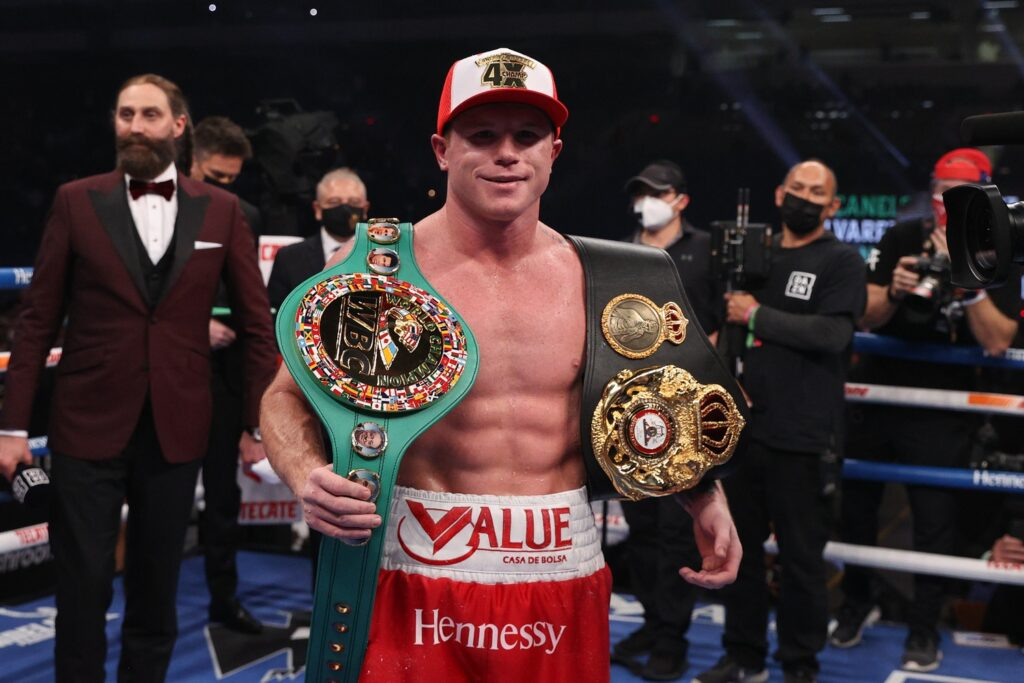 Dec 19, 2020; San Antonio, TX, USA;   Canelo Alvarez (red trunks) celebrates after defeating Callum Smith (white trunks) during their WBA, WBC and Ring Magazine super middleweight championship bout at the Alamodome in San Antonio, TX. Mandatory Credit: Ed Mulholland/Handout Photo via USA TODAY Sports