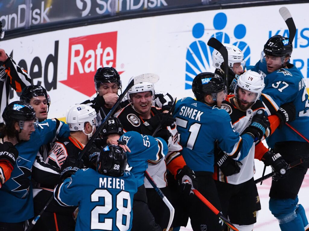 Apr 14, 2021; San Jose, California, USA; Anaheim Ducks and San Jose Sharks players in a fight during the third period at SAP Center at San Jose. Mandatory Credit: Kelley L Cox-USA TODAY Sports