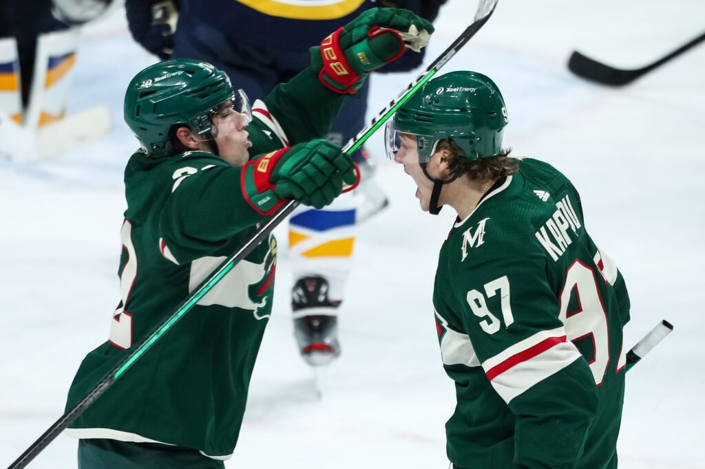 Apr 29, 2021; Saint Paul, Minnesota, USA; Minnesota Wild left wing Kevin Fiala (22) celebrates with left wing Kirill Kaprizov (97) after Kaprizov scored a goal against the St. Louis Blues in the third period at Xcel Energy Center. Mandatory Credit: David Berding-USA TODAY Sports