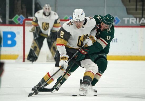 May 3, 2021; Saint Paul, Minnesota, USA; Vegas Golden Knights defenseman Zach Whitecloud protects the puck from Minnesota Wild left wing Zach Parise (11) during the first period at Xcel Energy Center. Mandatory Credit: Nick Wosika-USA TODAY Sports